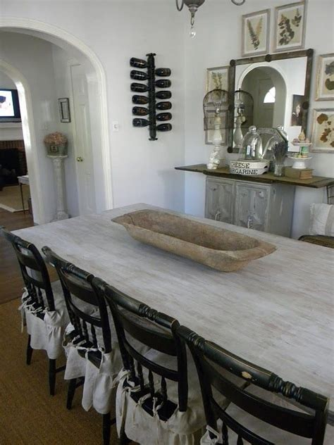 love  light grey washed table   black chairs