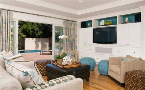 colorful curtains and sliding glass doors separate the