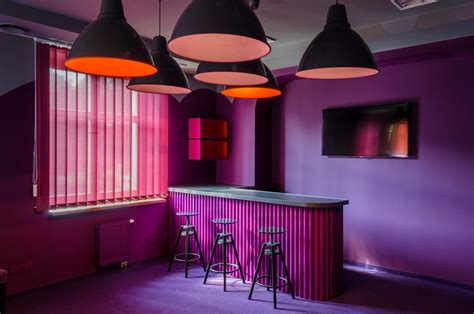 """""""Orange meets purple"""" office lounge and recreational space"""