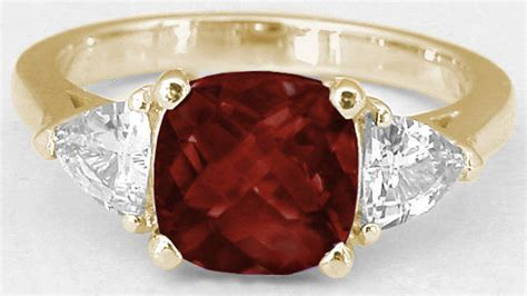 cushion cut garnet engagement ring   yellow gold