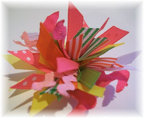 pom pom bow spikey pom pom hair clip the ribbon retreat blog