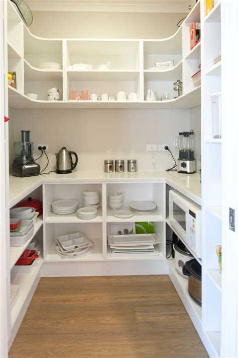 a walk in pantry is a great storage saver but also has a