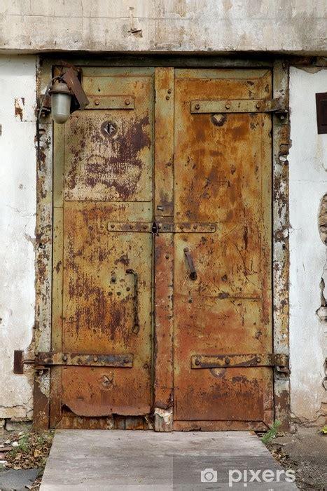 rusty  metal door   abandoned factory wall mural