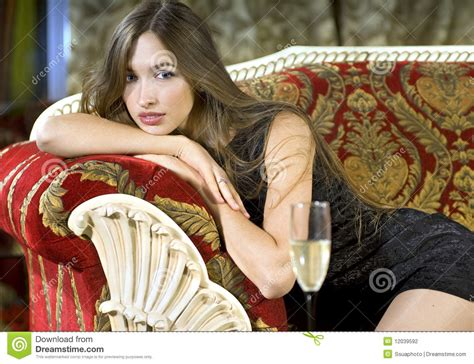 rich woman   red expensive sofa stock photo image