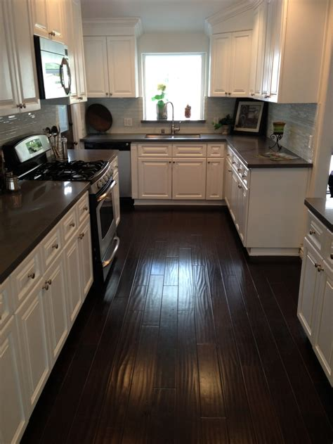 kitchen dark counters dark floors white cabinets