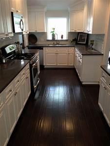 Kitchen Dark counters dark floors white cabinets