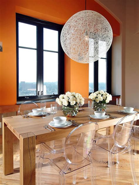Orange Penthouse Dining Room With Lucite Ghost Chairs Hgtv