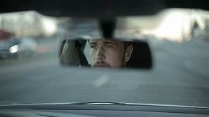 Man Looking Through Rear View Mirror. Stock Footage Video ...