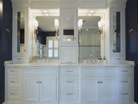 double white vanities  mirrored upper cabinets