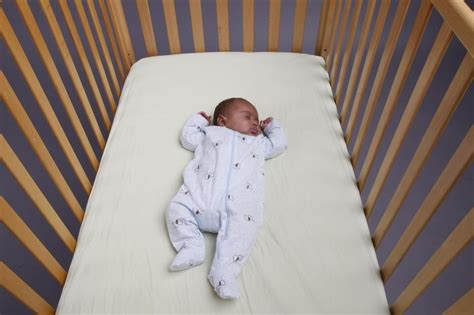 getting baby to sleep in crib officials co sleeping cluttered cribs top