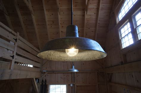 rustic barn lights give vintage feel to new barn