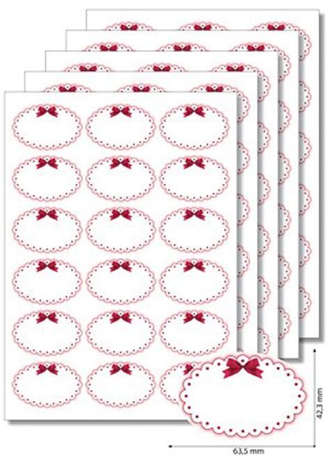 etiketten oval roter rahmen mit schleife  blatt