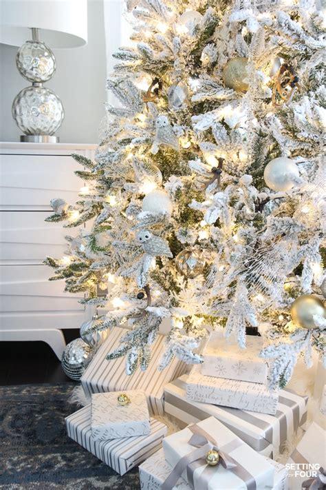 elegant decorated flocked christmas trees