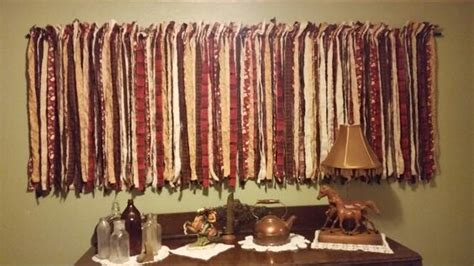 curtain made from strips of torn fabric home decor