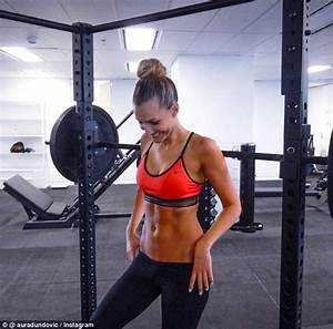 Laura Dundovic shows off ripped torso in revealing gym ...