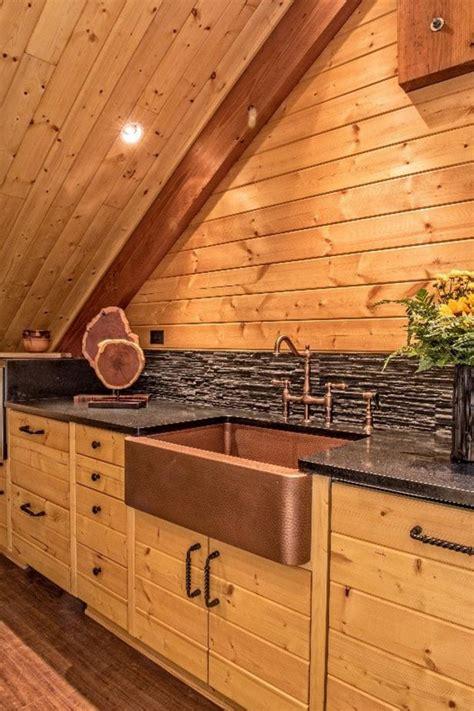 natural wood loft kitchen  copper farmhouse sink