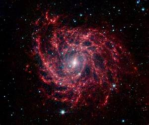 Spiral Galaxy Glows Like a Cosmic Spider Web | NASA's ...