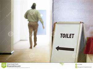 Man going to toilet stock photo image of board symbol for How to go to the bathroom in public