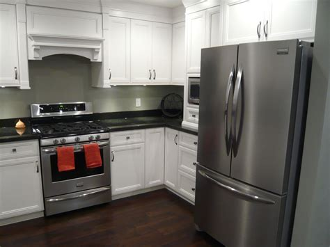 black kitchen cabinets white appliances white cabinets black granite hardwood stainless 7883