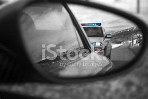 lightguard emergency lighting equipment police car reflected in side mirror of speeding car stock