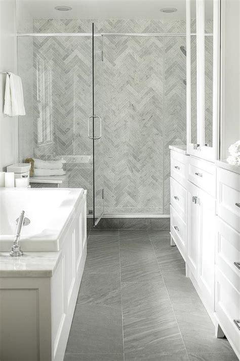 white  gray master bathroom  gay marble chevron floor transitional bathroom