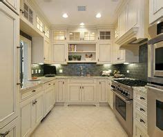 kitchen and cabinets by design beige linen colored kitchen cabinets with slightly darker 7665