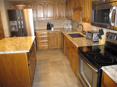 best hardware for oak cabinets simple update to kitchen with s s appliances refinished