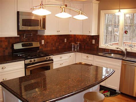 brown cabinets with white countertops tan brown granite white cabinets backsplash ideas