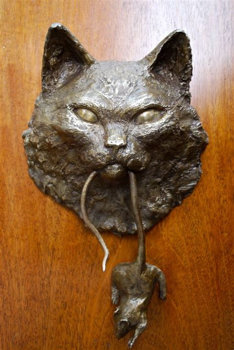 cat door knocker we re all mad inhere as it is surviving insanity