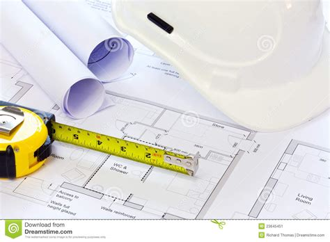 Home Design Game Tape Measure : Hard Hat And Building Plans Stock Image