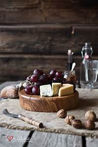 Cheese board, rustic place mat, wooden surface. | Food, Catering food, Sushi platter