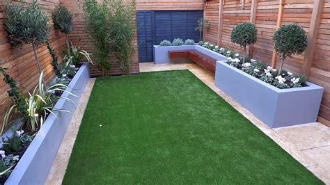 modern garden design small london cedar screen grey raised bed artificial grass cream paving