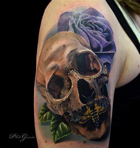 mechanical  skull tattoo  left  sleeve