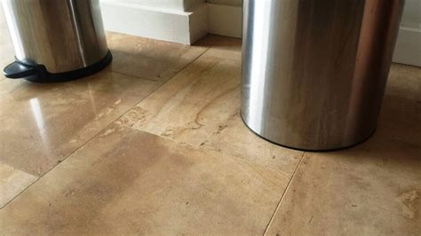 dealing with kitchen stains on limestone floor tiles