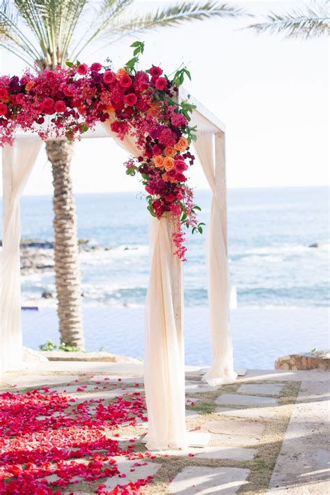 beach wedding ideas beach ceremony drenched in flowers