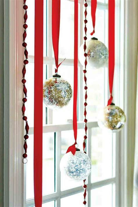 hanging christmas ornaments in window 7 festive decorations to hang in your windows for the holidays
