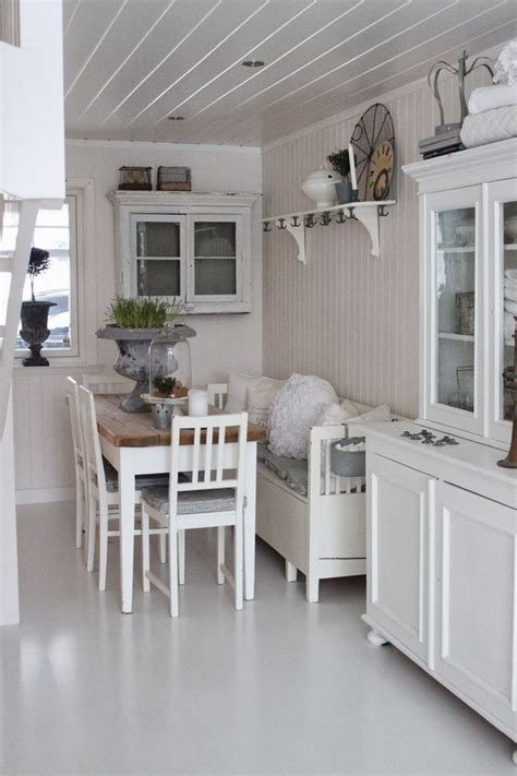 Small, narrow breakfast room with table, hanging cabinet