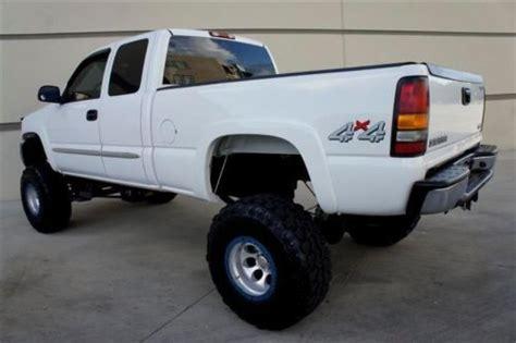 purchase  custom lifted  gmc sierra  big   tires mt wheels bedliner  miles
