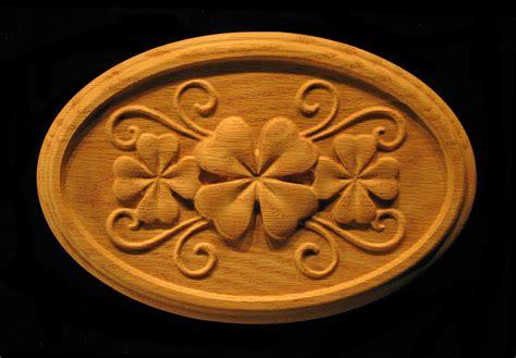 onlay shamrock clover  oval carved wood
