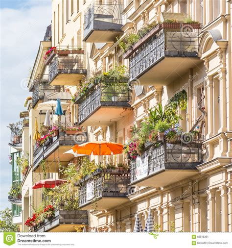 Traditional European Balcony With Colorful Flowers And