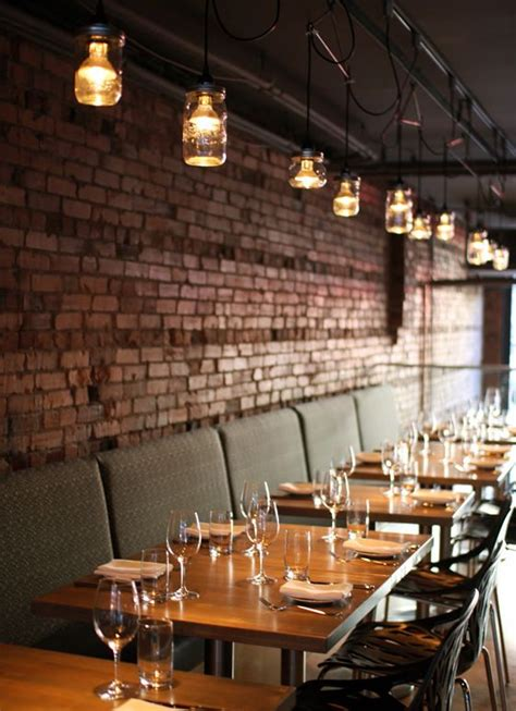 brick cuisine the tables and historic exposed brick great atmosphere at l abattoir vancouver