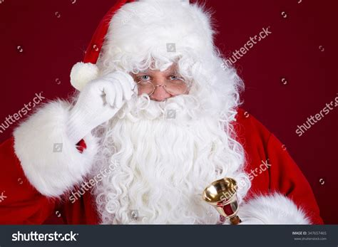 traditional santa claus ringing on santa claus ringing a bell it s christmas time stock photo 347657465 shutterstock
