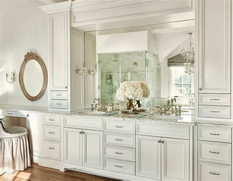 sinks flanked  cabinets transitional