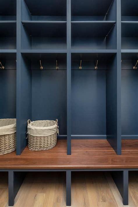 dark blue open mudroom lockers  fitted  brass hooks