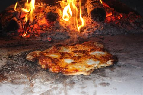 cooking pizza in a wood fired oven 28 images wood pizza ovens in discover the