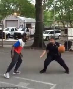 nypd officers play basketball   group  teens
