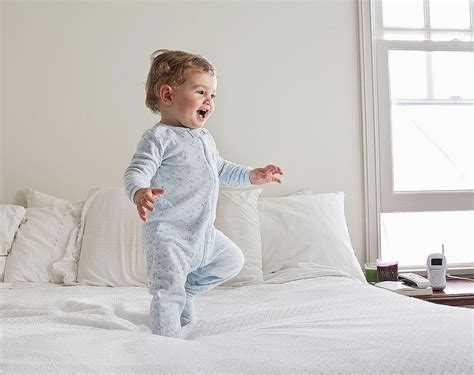 Does Your Baby Need A Blanket Sleeper For Bedtime? Pigs In Blanket Puff Pastry Make Ahead Cellular Cot Target Fleece Tie Twin Size White Fluffy For Bed When Can A Toddler Sleep With Pillow And Minky Animal Pattern Good Housekeeping Review Electric Blankets Queen Cotton Satin Trim