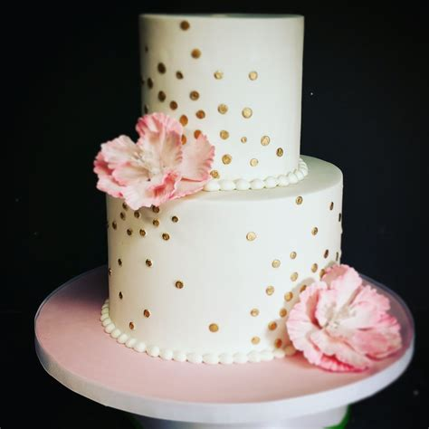 pink and gold polka dot birthday cake with peony blue