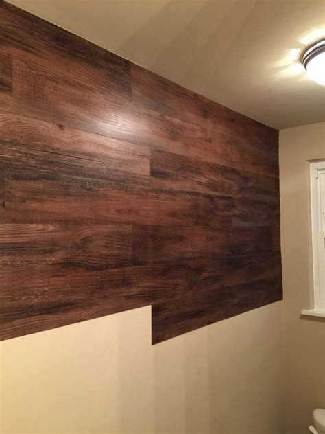 vinyl planks on wall quot the bathroom is small and my son drenches the wall quot so this mom did something brilliant