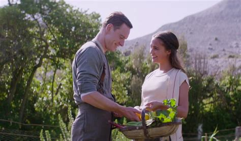 michael fassbender sings to vikander in light